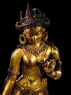 Tara, female bodhisattva of compassion. 13th C. Nepalese, Gilt-copper with inlaid stones. 2.3 feet tall (detail).