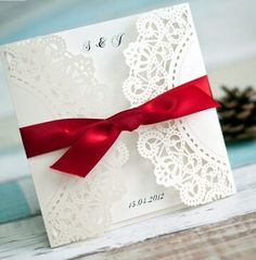 classic white and red laser cut wedding invitations with ribbons