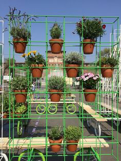 A4A Rivolta Savioni studio's urban garden solution is situated in Milano. Easily movable on reused bicycle wheels, the public garden—called 'Why not in the garden?'—was rolled out into the city square. The mobile garden can bring a wall of flowers or rows of edible plants to nearly any outdoor area. The wheeled gardens took on two forms, a vertical module with metal frame espaliers that allow flower pots to hang, and horizontal modules with a flat table top for flower beds. Each of module is…