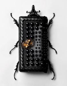 A wild studded clutch from Bottega Veneta.
