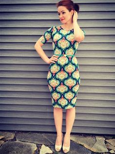 Lularoe Julia Dress - so easy to dress it up with heels and a thin, bright color belt. It's also very comfy so for a more casual look wear it with flips flops and grab that large bag you need when you're on the go. Outfit for spring, summer and fall #LLR #Lularoe
