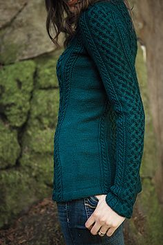 A twist on a classic Aran pullover, this sweater has a feminine touch. It's gorgeous shaping is designed to flatter. Crafted in Knitpicks' Galileo, you're sure to have eyes turning toward you, a vibrant, modern princess.