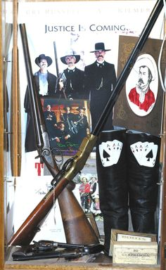 """J. J. Weston Double-Barrel Coach Gun and a pair of Colt Cavalry Model SAA Revolvers used by Powers Boothe in the movie """"Tombstone"""""""