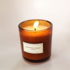 Inspired by the fresh evergreens that grow in the airy mountains of Montana, we created a scent reminiscent of nature in a far-off place. A Brooklyn Candle Studio original blend of blue spruce, pine, Ginger Essential Oil, Essential Oil Candles, Essential Oils, Glass Candle, Candle Jars, Candle Labels, Candle Shop, Glass Jars, Soy Candles