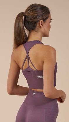 Ribbed and lace detailing of the Energy Seamless Crop Vest enhances your physique whilst supporting your movements, with a non-slip feel for lasting comfort. Featuring removable pads, stunning waterfall strap design and complete with printed Gymshark logo. Coming soon in Purple Wash.