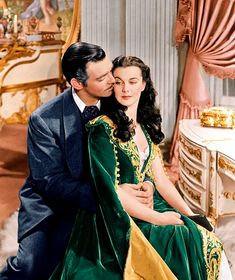 Clark Gable as Rhett Butler and Vivien Leigh as Scarlett O'Hara in the film Gone With the Wind (made in 1939), set in Georgia in the 1860s.  Costumes shown are from American civil war period (Southern). Here is the full view of Scarlett's dress.