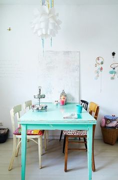 Minty table, white walls, mismatched chairs. (from Hippie Hippie Chic)