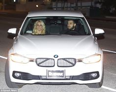 Nice wheels:The 34-year-old hitmaker and themodel-personal trainer arrived in a white BM...