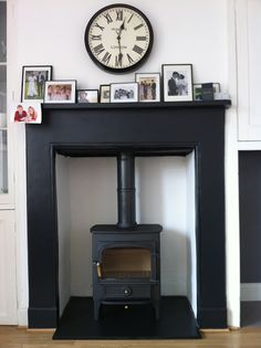Wood burning stove black fireplace surround