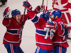 Montreal Canadiens right wing P.A. Parenteau, left, celebrates with Montreal Canadiens defenceman P.K. Subban and Montreal Canadiens defenceman Andrei Markov, right after Markov scored against Detroit Red Wings goalie Jimmy Howard during NHL action at the Bell Centre in Montreal on Thursday April 9, 2015.
