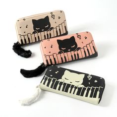 """The sleepy cutie **Pooh-chan** is enjoying playing some music on a piano on this **long wallet!** Available in **black, ivory,** and **pink,** each is made using **PU and acrylic** and is approximately **3.7"""" by 7.7"""".** The zipper pull looks like a **soft cat tail,** and inside you'll find **slots** for cards and cash, as well as a **zippered pocket** to keep your change in! #jfashion #kawaii"""