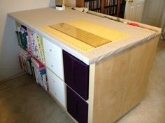 http://www.apartmenttherapy.com/make-a-sewing-table-from-ikea-expedits-ikea-hackers-181497
