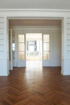 love these wood floorsfloors, built ins, french doors!