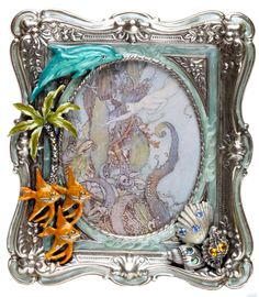 """KIRKS FOLLY  SEA DREAM MERMAID SILVERTONE PICTURE FRAME #KirksFollyA school of angelfish, shells accented with faceted colored and aurora borealis crystals, a swaying palm tree with crystal studded trunk, and a jumping dolphin with a blue crystal eye add to the whimsy of this beautiful frame.  The frame measures approximately   5-1/2"""" high  x 5"""" wide  It has been designed to hold a 4"""" x 3"""" picture"""