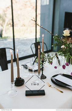 A composition of twigs, foliage and tulips, brought a dash of colour to this simplistic table setting, boasting black elements. Wedding Stationery Inspiration, Wedding Inspiration, Wedding Ideas, Monochrome Weddings, Wedding Reception, Reception Ideas, Wedding Table Numbers, Perfect Party, Event Decor
