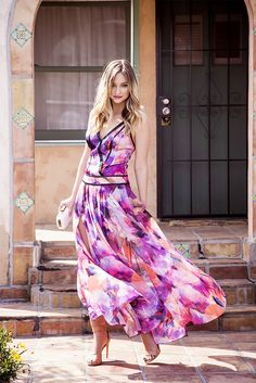 Liz Cherkasova of Late Afternoon in a Carnivale maxi dress, a multicolored clutch and Cari sandals // #streetstyle #fashion #style