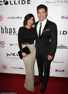 Cute couple: Extra's Mario Lopez looked suave as he arrived with wife Courtney...