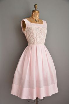 Vintage 1950s dress, soft pink cotton with a lace bodice, bust darts with a flattering nipped waist fit, full skirt, side metal zipper.