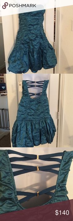 BCBG Dress Sz L STUNNING Nwts New with tags! Super Sexy Super Chic Teal Mini Strapless, puffy bubble hem, best feature is unique crisscrossing straps in back- Fantastic for upcoming Prom season, wedding or perhaps a special V-day date. ❤️ BCBG Dresses Mini