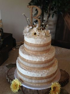 Rustic Theme Wedding Cake Borders Are Burlap With Lace And Flowers Are Fake