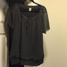 Polka Dot Top Cute top with beaded string ties on top. Has a banded bottom. Tops Blouses