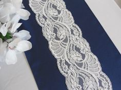 White table cloth, blue runner, white lace