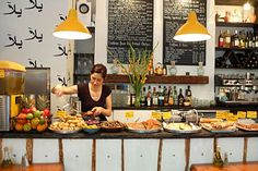 Yalla Yalla in Soho is a cool Lebanese restaurant that serves affordable food. We love the yellow accents in their interior design.