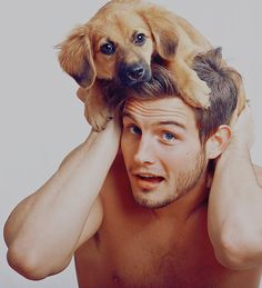 Nico Tortorella with a Puppy on His Head