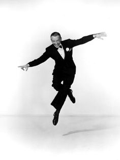 Fred Astaire...I don't think he ever walked without bending he's knees, so he could be ready to just GO into the move!