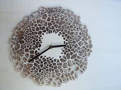 Last time, we introduced you to a Voronoi-inspired bookshelf and now, we have the Giraffe Clock that is based on the Voronoi algorithm. A Voronoi diagram is a method of dividing space into different regions. The inspiration for the Giraffe Clock came from the intricate patterns, such as the spots on giraffes, microscopic image of a leaf or the pattern of a turtle shell. These patterns follow a simple mathematical formula and are called Voronoi.