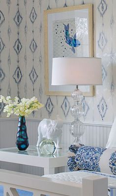 Blue and white bedroom design with clear Venetian Murano glass lamps; blue bedroom decor; bedroom lighting