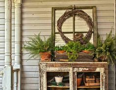.old window wreath sitting on top of old cabinet