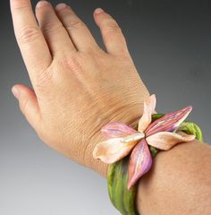 This is the orchid bracelet I just finished taping for a segment of Beads, Baubles and Jewels! It will air later in the year I believe!  I'll keep ya posted.