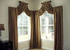 Totally don't love this, but I love the idea of creating a shaped window with the drapes alone.