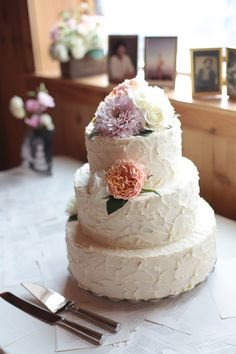 buttercream wedding cake with pastel flowers...  @Caleb Millwood  I like this textured look, the flowers could be different, haha, but i basically pinned it because of the textured tiers :)
