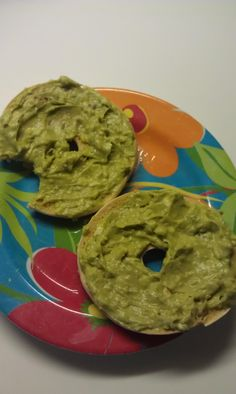 wheat bagel with avacado mixed with herb laughing cow cheese