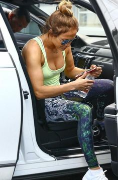 Jennifer Lopez steps out in homegrown endless leggings by Niyama Sol and white Adidas sneakers.