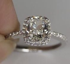 White gold or platinum. Cushion or radiant cut - with or without halo. SUPER thin, straight band with diamonds.