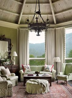 Muted lime green living room with damask chairs and vaulted ceiling -- interior design: Francie Hargrove