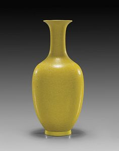 Chinese Yellow Glazed Porcelain Vase  Chinese Qianlong-style, yellow monochrome glazed porcelain vase; bottle-form with allover incised anhua writhing dragons and pearls among clouds, possibly Minguo, seal mark; H: 8""