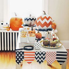 Conjure a holiday spread with a line-up of patterned pumpkins and delicious eats. - FamilyCircle.com