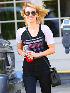 Emma Roberts added a dose of hippy chic to her casual ensemble with perfectly round old-school shades!