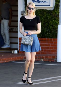 Emma Roberts wears a black crop top with a denim circle skirt and reptile-print bag with L.K.Bennett Parka Black Suede Chunky Heels