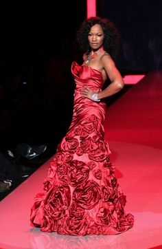 Lady in Red! Garcelle Beauvais stunned in her rose-embellished Monique Lhuillier dress while promoting women's heart health.