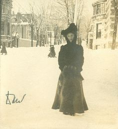 Marjory Meredith Clouston (identified as Daw) standing at the corner of Drummond and Sherbrooke Streets in Montreal during winter in what is likely 1902. Behind her can be seen the north end of Drummond Street as it ascends Mount Royal. The photograph closely resembles at least one photograph found on page 36 of the first album of the collection. Both photographs were taken at the same location during winter.