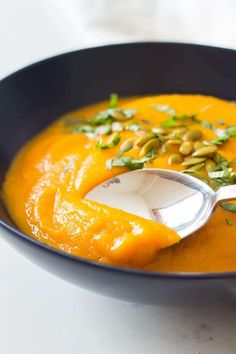 This healthy roasted Butternut Squash and Carrot Soup is perfect cold weather food and is super easy to make. The recipe is vegan, gluten free, clean eating and paleo. Round out the meal with your protein of choice - I like cooked quinoa