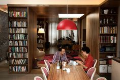 Bookshelves as space dividers Modern loft renovation in Brooklyn, New York