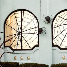 Give giant spiders (created from plastic-foam balls) a place to call home with window webs spun from a few crafts store supplies.