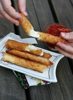 Homemade mozzarella sticks (made with egg roll wrappers). Crispy, cheesy, and incredibly easy to make. No deep fryer required! Please repin.