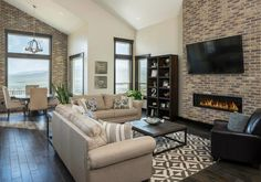 What Colors Look Best With Brick ... Modern Wall Paneling, Brick Wall Paneling, Living Room Panelling, Wood Panel Walls, Living Room Brick Wall, Paneling Ideas, Wainscoting Ideas, Paneled Walls, Brick Cafe